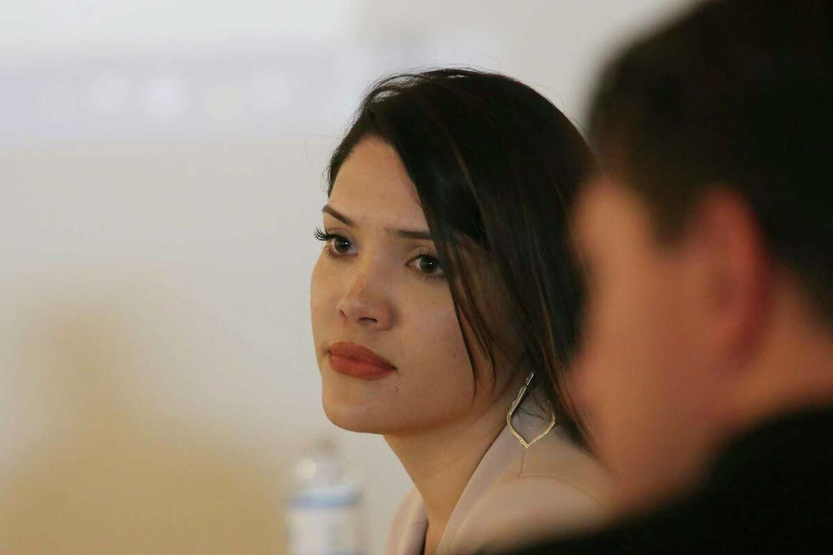 Krista Cooper-Nurse waits to testify in the arbitration hearing of fired San Antonio police officer Justin Ayars, right, on June 26, 2019. Ayars was fired by Police Chief William McManus. Cooper-Nurse alleged Ayars hit her with a rock in May 2018. The attack fractured her face in three different places. He was fighting to get his job back.