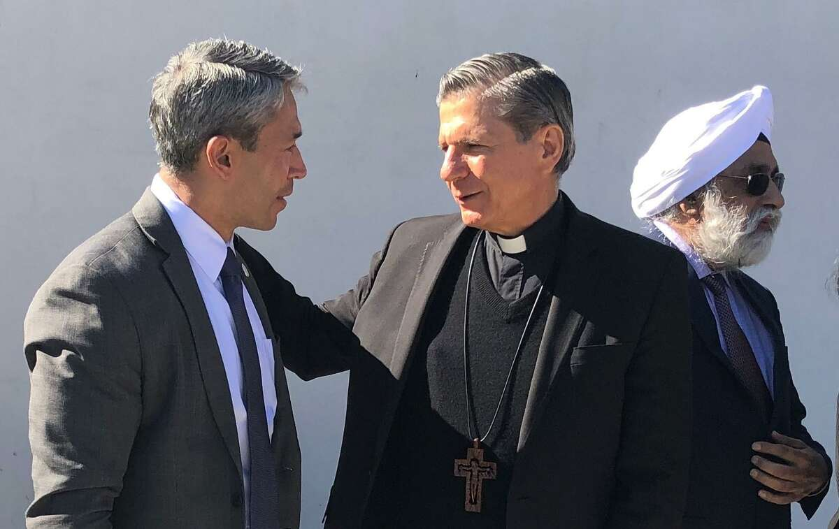 San Antonio Mayor Ron Nirenberg confers with Archbishop Gustavo García-Siller after religious community leaders and Interfaith San Antonio Alliance members signed a proclamation at Haven for Hope Chapel to improve the availability of affordable housing for the city's homeless.