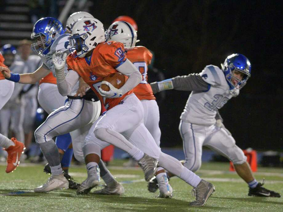 Danbury's Malachi Hopkins (2) cuts through the line in the football game between Fairfield Ludlowe and Danbury high schools, Friday night, November 15, 2019, at Danbury High School, Danbury, Conn. Photo: H John Voorhees III / Hearst Connecticut Media / The News-Times