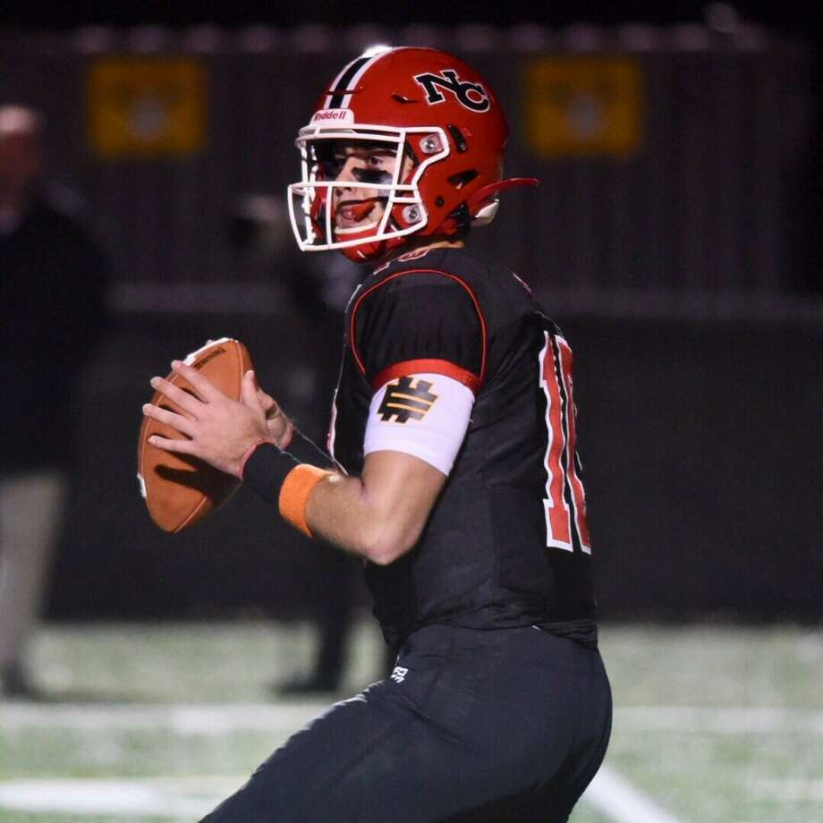 New Canaan's Drew Pyne looks downfield for a receiver during the Rams' football game against Wilton at Dunning Field on Friday. Photo: David Stewart / Hearst Connecticut Media / Connecticut Post