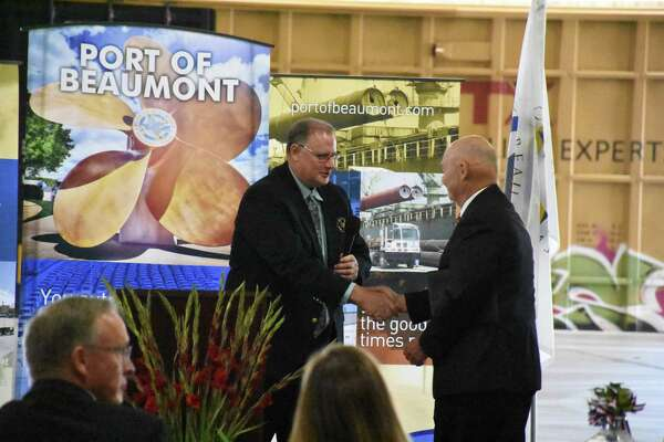 Chris Fisher, Port of Beaumont Director and CEO, shakes hands with Admiral Mark Buzby, U.S. Department of Transportation Maritime Administrator, Friday morning at the celebration of an $18 million grant for port projects.