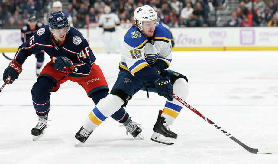 The Blues' Robert Thomas, right, carries the puck away from Columbus Blue Jackets' Dean Kukan in the third period of Friday night's game in Columbus, Ohio. Photo: AP Photo
