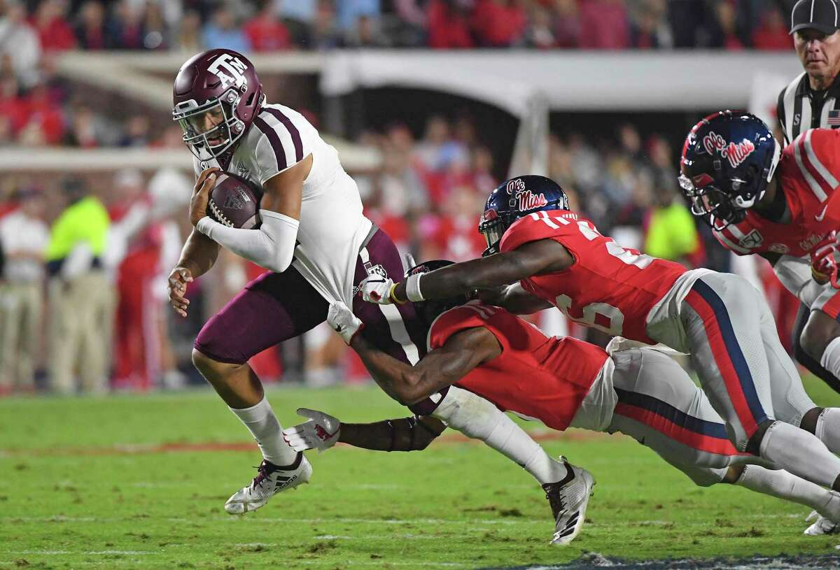 Texas A&M quarterback Kellen Mond tries to get away from Mississippi's defense during the Aggies' current three-game winning streak.
