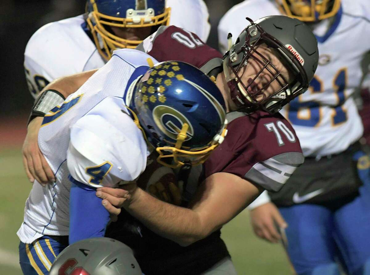 Gouverneur's Mitchell Tyler (04) is tackled by Stillwater's Brian Mcneil (70) during a Class C state quarterfinal football game in Rotterdam, N.Y., Friday, Nov. 15, 2019. Gouverneur won 10-2. (Hans Pennink / Special to the Times Union) ORG XMIT: 111619_hsfb2HP112