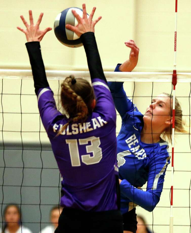 La Vernia's Meghan Stiefer #4 has her slam blocked by Fulshear's Shelby Tally #13. Richmond Fulshear defeated La Vernia 3-0 in Region IV-4A semifinal volleyball match at Littleton Gym on Friday, November 15, 2019 Photo: Ronald Cortes/Contributor / 2019 Ronald Cortes