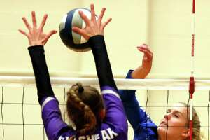 La Vernia's Meghan Stiefer #4 has her slam blocked by Fulshear's Shelby Tally #13. Richmond Fulshear defeated La Vernia 3-0 in Region IV-4A semifinal volleyball match at Littleton Gym on Friday, November 15, 2019