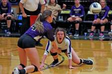 Navarro's Carolyn Burch #2 watches as Navarro's Nelly Brumley #4 tries to pick up a dig in Region IV-4A semifinal volleyball match between Navarro and Caldwell at Littleton Gym on Friday, November 15, 2019