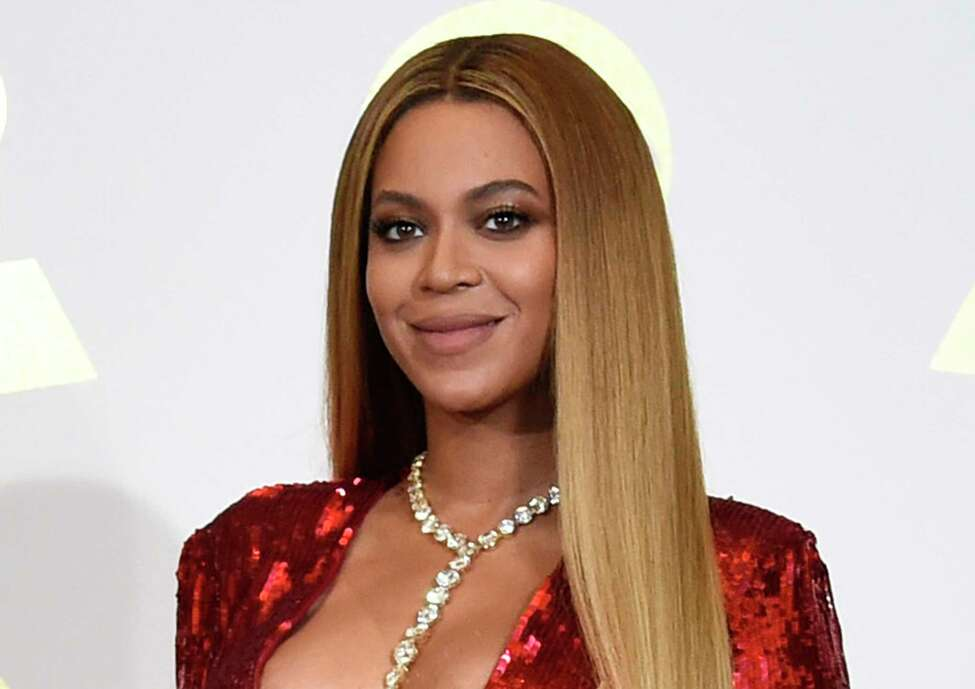 FILE - In this Feb. 12, 2017 file photo, Beyonce poses in the press room at the 59th annual Grammy Awards in Los Angeles. The singer reveals she had an emergency Caesarean section when she delivered her twins. In a series of essays in Septembera€™s Vogue magazine, she says she was 218 pounds and was swollen from toxemia. The 36-year-old says they spent many weeks in intensive care and her husband, Jay Z, was a€œsuch a strong support system.a€ (Photo by Chris Pizzello/Invision/AP, File)