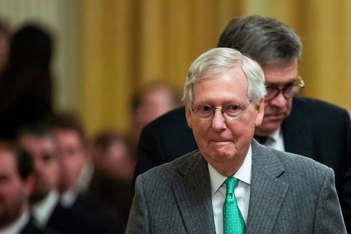FILE - In a Wednesday, Nov. 6, 2019 file photo, Senate Majority Leader Mitch McConnell, R-Ky., front, and Attorney General William Barr arrive before President Donald Trump speaks in the East Room of the White House about his judicial appointments, in Washington. McConnell said Kentucky Gov. Matt Bevin a€œhad a good four yearsa€ during a visit to a steel plant in Kentucky Monday, Nov. 11, 2019. Bevin ran a close race against Democrat Andy Beshear but is trailing by about 5,000 votes ahead of a re-canvass on Thursday, Nov. 14, 2019. (AP Photo/Manuel Balce Ceneta, File)