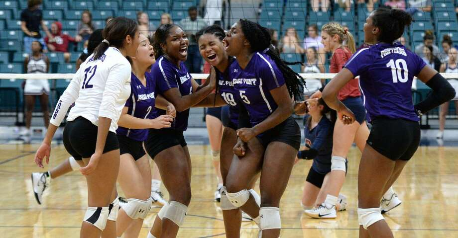 The Ridge Point Panthers celebrate a point during the second set of a Class 6A Region III bi-district volleyball playoff match against the Tompkins Falcons on Tuesday, November 5, 2019 at the Leonard Merrell Center, Katy, TX. Photo: Craig Moseley/Staff Photographer