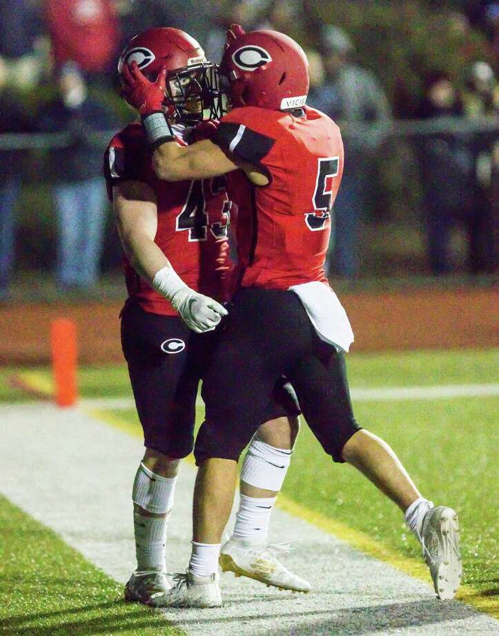 Cheshire's Jake McAlinden celebrates his first-half touchdown with teammate Alec Frione against Sheehan on Friday. Photo: John Vanacore / For Hearst Connecticut Media / (C)John H.Vanacore