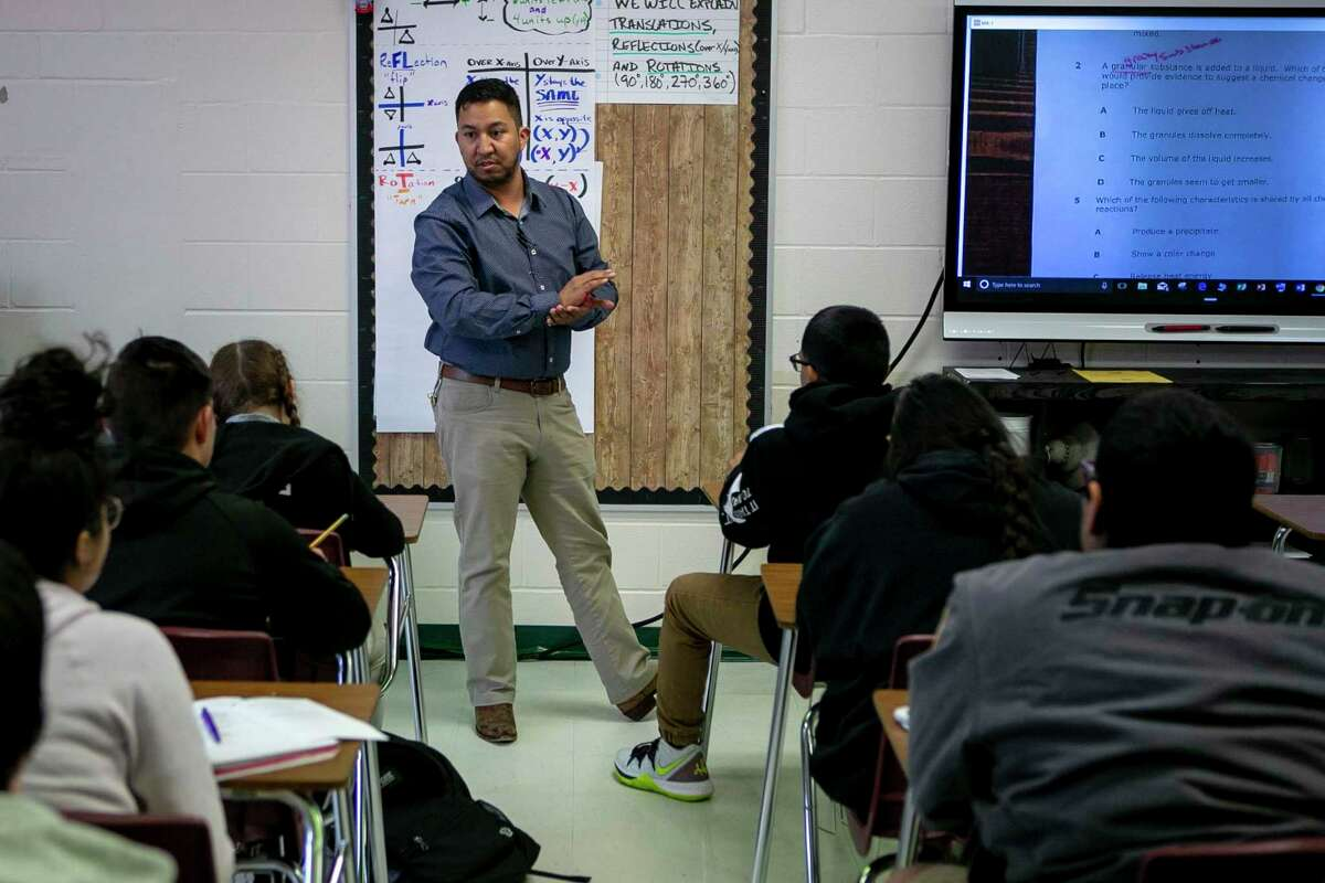 Eighth grade science teacher Adam Rodriguez addresses his students at Cotton Academy. Cotton has been named a high-performing high-poverty school by the Houston-based nonprofit Children at Risk for its middle school performance.
