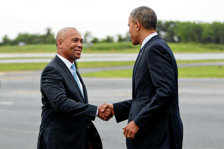 President Barack Obama is greeted in June 2014 by then-Massachusetts Gov. Deval Patrick, upon his arrival at Worcester Regional Airport in Worcester, Massachusetts. Photo: Pablo Martinez Monsivais | Associated Press