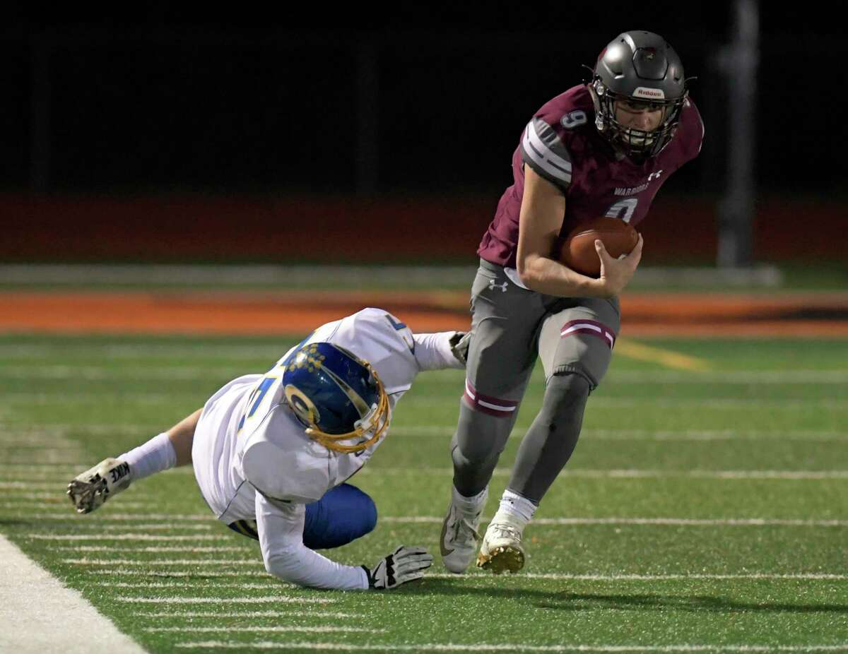 Stillwater's James Galarneau (9) runs the ball against Gouverneur during a Class C state quarterfinal football game in Rotterdam, N.Y., Friday, Nov. 15, 2019. Gouverneur won 10-2. (Hans Pennink / Special to the Times Union) ORG XMIT: 111619_hsfb2HP109
