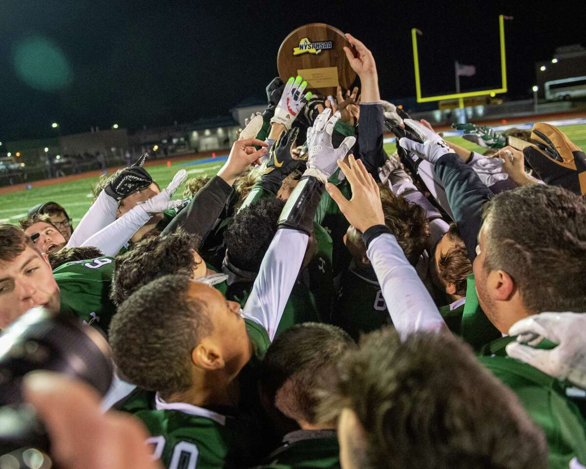 The Shenendehowa football team hoists the Class AA New York state quarterfinal plaque after beating Pine Bush at Shaker High School on Friday, Nov. 15, 2019 (Jim Franco/Special to the Times Union.)