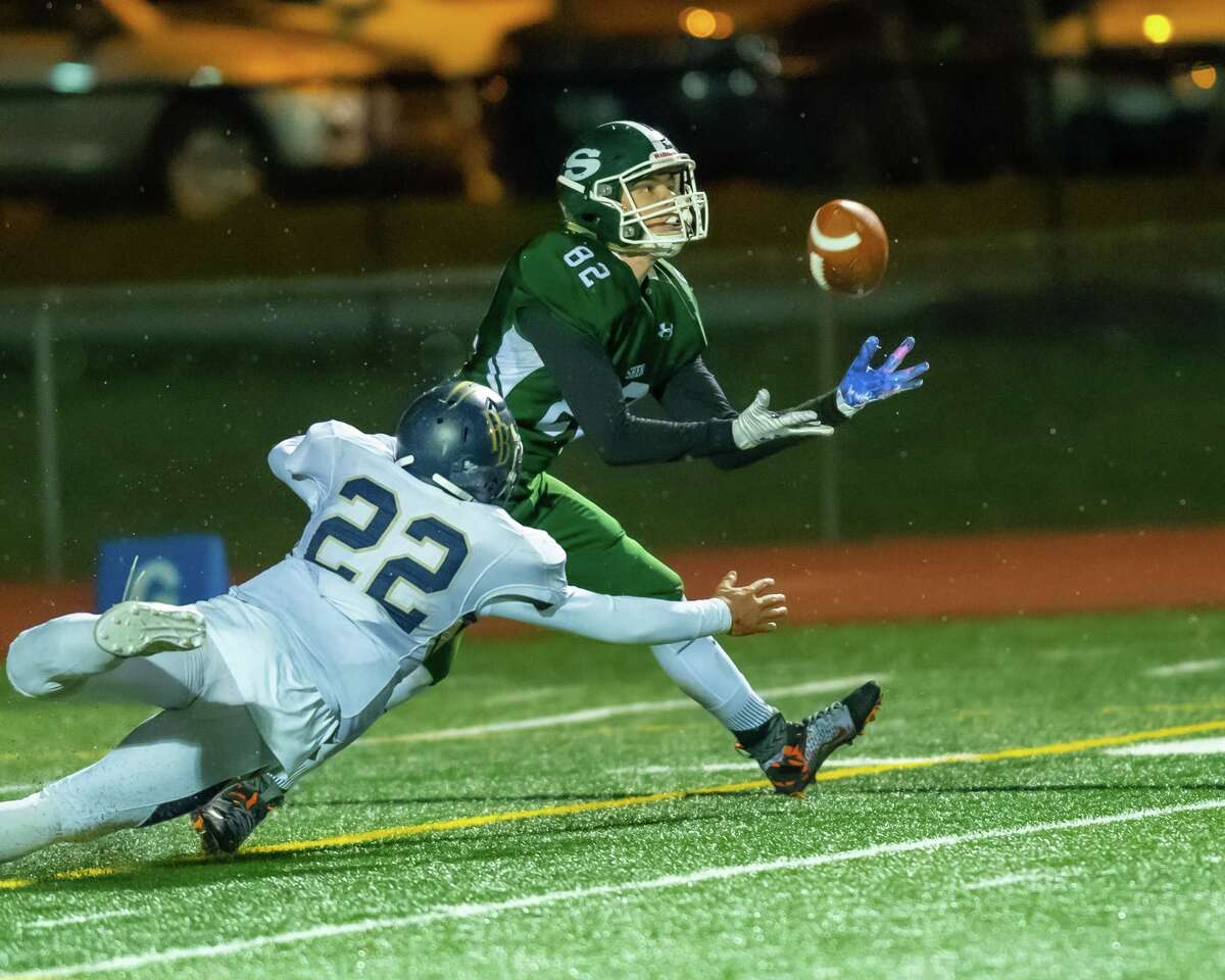 Shenendehowa receiver Dustin Lewis catches a pass in front of Pine Bush defender Kenneth Holland during the Class AA New York state quarterfinals at Shaker High School on Friday, Nov. 15, 2019 (Jim Franco/Special to the Times Union.)