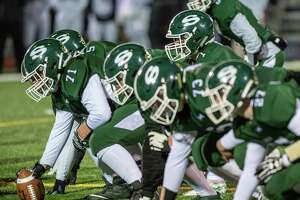 Shenendehowa quarterback Brody Vincenzi takes a snap behind his offensive line during the Class AA New York state quarterfinals against Pine Bush at Shaker High School on Friday, Nov. 15, 2019 (Jim Franco/Special to the Times Union.)