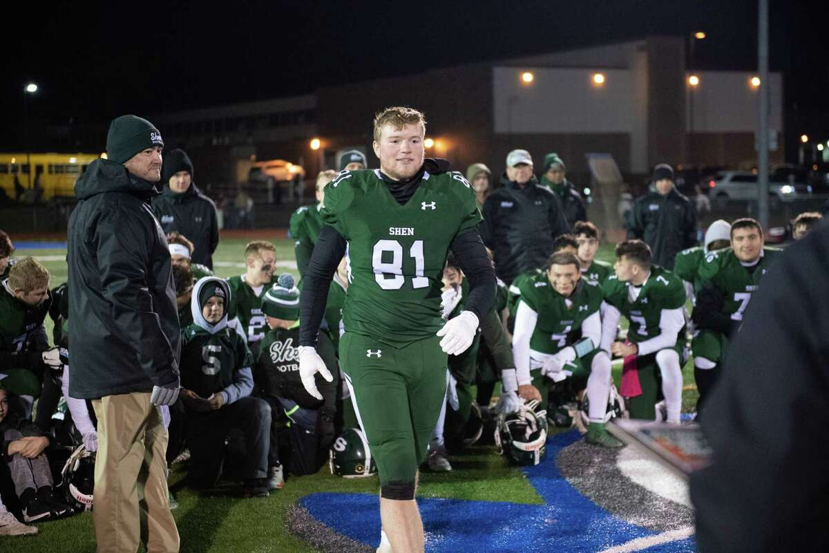 Shenendehowa defensive end Patrick McCane goes to get the award for being named the team defensive player of the Class AA New York state quarterfinals against Pine Bush at Shaker High School on Friday, Nov. 15, 2019 (Jim Franco/Special to the Times Union.)