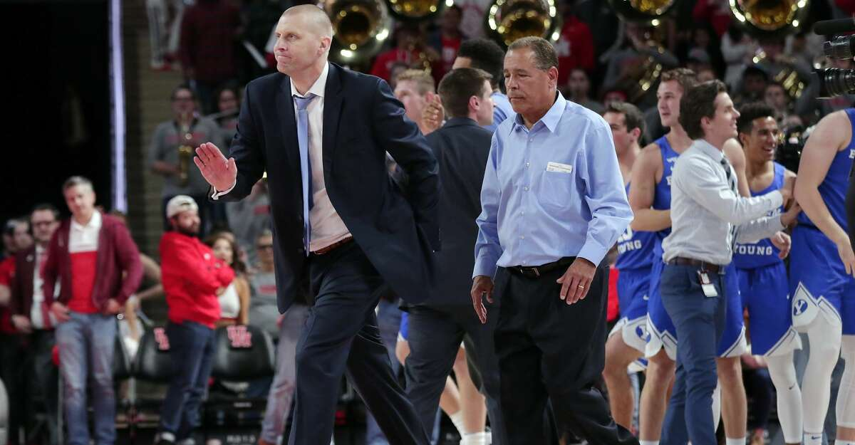 Brigham Young head coach Mark Pope and Houston head coach Kelvin Sampson leave the court after Brigham Young's stunning last second basket to win by one point after their NCAA basketball game Friday, Nov. 15, 2019 in Houston, TX.