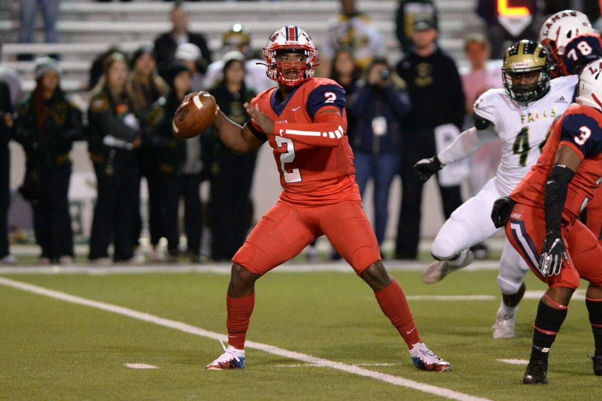 Troy Tisdale (2) of Lamar prepares to release a pass during the first quarter of a Class 6A Division I Region III bi-district football playoff game between the Lamar Texans and the Cy Falls Eagles on Friday, November 15, 2019 at Delmar Stadium, Houston, TX.