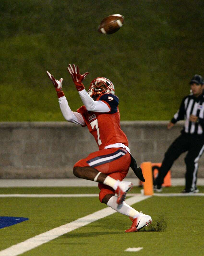 Ka'Veon Griffin (7) of Lamar makes a touchdown reception during the fourth quarter of a Class 6A Division I Region III bi-district football playoff game between the Lamar Texans and the Cy Falls Eagles on Friday, November 15, 2019 at Delmar Stadium, Houston, TX.