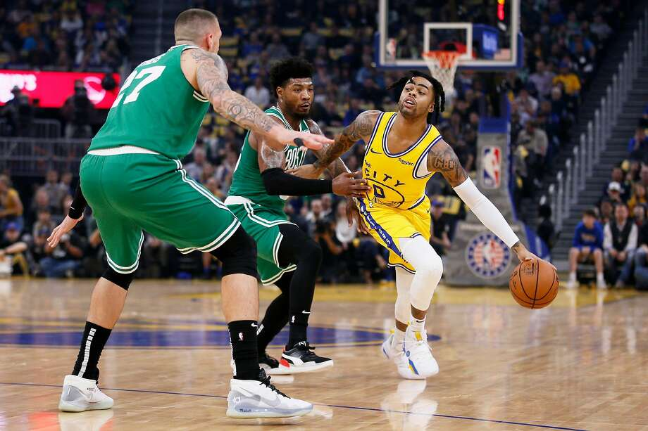 Golden State Warriors guard D'Angelo Russell (0) while defended by Boston Celtics guard Marcus Smart (36) and forward Daniel Theis (27) in the first period of an NBA game at Chase Center on Friday, Nov. 15, 2019, in San Francisco, Calif. Photo: Santiago Mejia / The Chronicle