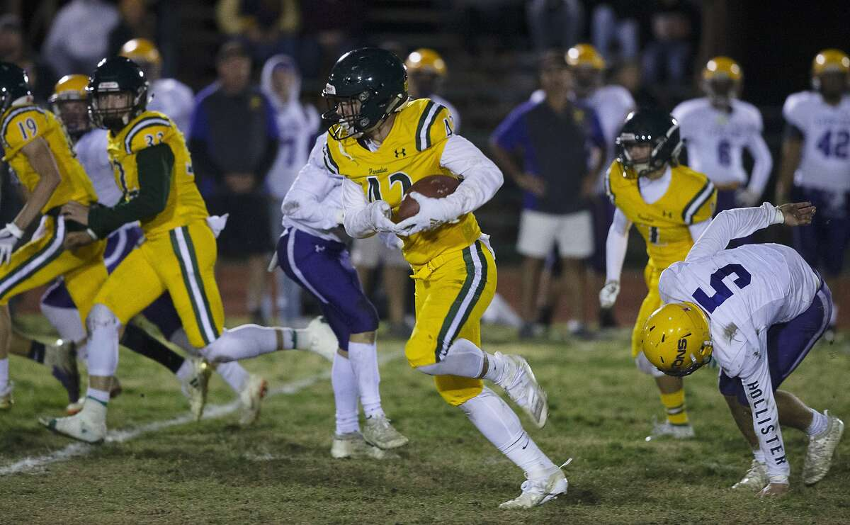 Paradise High School running back Tyler Harrison, center, runs for the end zone against Live Oak High during the first half of a Northern California Division 3 playoff game in Paradise, Calif., Friday, Nov. 15, 2019.