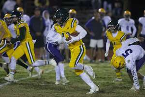 Paradise High School running back Tyler Harrison, center, runs for the end zone against Live Oak High during the first half of a Northern California Division 3 playoff game in Paradise, Calif., Friday, Nov. 15, 2019. The Paradise High Bobcats had an undefeated season and made it to the playoffs a year after the deadliest wildfire in California history that killed dozens and destroyed nearly 19,000 buildings including the homes of most of the players. (AP Photo/Rich Pedroncelli)