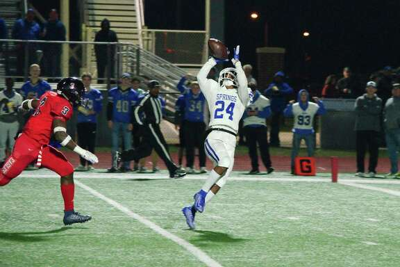 Clear Springs' Isaiah Bibb (24) pulls down a touchdown pass Friday at The Rig.