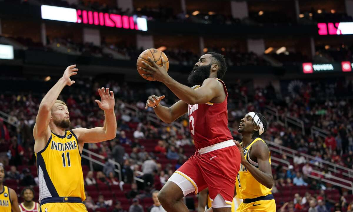 Houston Rockets' James Harden (13) goes up for a shot as Indiana Pacers' Domantas Sabonis (11) and Justin Holiday (8) defend during the second half of an NBA basketball game Friday, Nov. 15, 2019, in Houston. The Rockets won 111-102. (AP Photo/David J. Phillip)