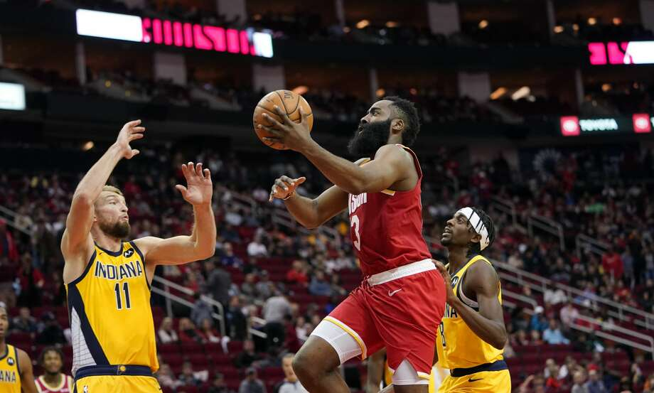 Houston Rockets' James Harden (13) goes up for a shot as Indiana Pacers' Domantas Sabonis (11) and Justin Holiday (8) defend during the second half of an NBA basketball game Friday, Nov. 15, 2019, in Houston. The Rockets won 111-102. (AP Photo/David J. Phillip) Photo: David J. Phillip/Associated Press