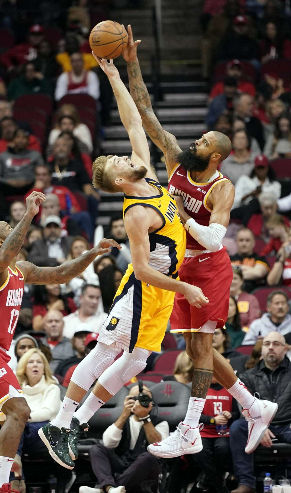 Indiana Pacers' Domantas Sabonis, left, has his shot blocked by Houston Rockets' Tyson Chandler during the second half of an NBA basketball game Friday, Nov. 15, 2019, in Houston. The Rockets won 111-102. (AP Photo/David J. Phillip)
