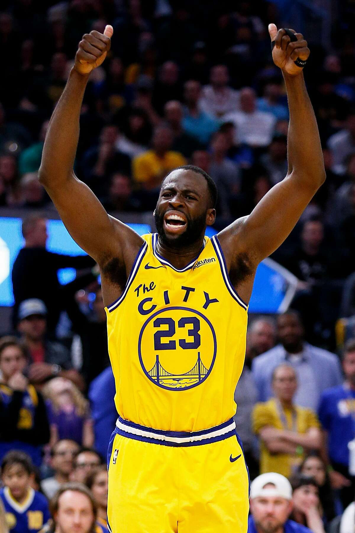 Golden State Warriors forward Draymond Green (23) calls to the officials after he fouled Boston Celtics forward Daniel Theis (27) in the second half of an NBA game against the Boston Celtics at Chase Center on Friday, Nov. 15, 2019, in San Francisco, Calif. The play was reviewed and overturned. Warriors have possession.