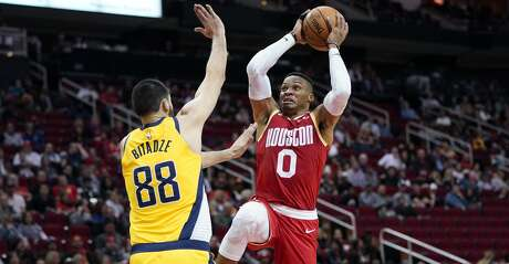 Houston Rockets' Russell Westbrook (0) goes up for a shot as Indiana Pacers' Goga Bitadze (88) defends during the second half of an NBA basketball game Friday, Nov. 15, 2019, in Houston. The Rockets won 111-102. (AP Photo/David J. Phillip)