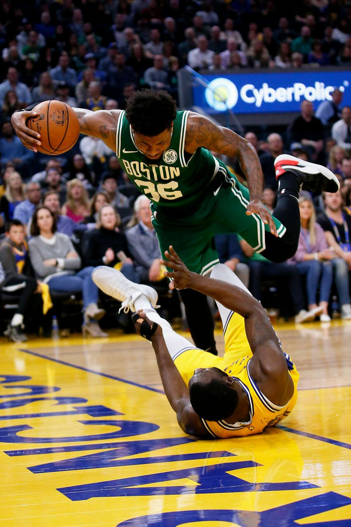 Boston Celtics guard Marcus Smart (36) is called for charging against Golden State Warriors forward Draymond Green (23) in the second half of an NBA game at Chase Center on Friday, Nov. 15, 2019, in San Francisco, Calif.