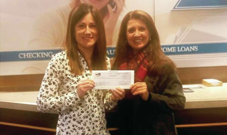 From left, DCECU Marketing Program Coordinator Teresa Cunningham presents the credit union's Pink Fund donation check to MacDonald Broadcasting/WKCQ Account Executive Dawn Pavelka. (Photo provided/Dow Chemical Employees' Credit Union)