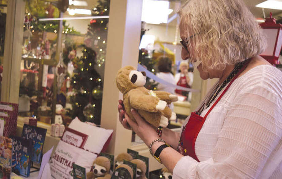 Barb Hansmeier of Jacksonville looks at a talking sloth Friday during the Passavant Auxiliary Bazaar at Passavant Area Hospital. The bazaar will continue from 10 a.m. to 3 p.m. today. Breakfast with Santa will be at 9:30 a.m. and a luncheon will have seatings at 11 a.m. and 1 p.m.