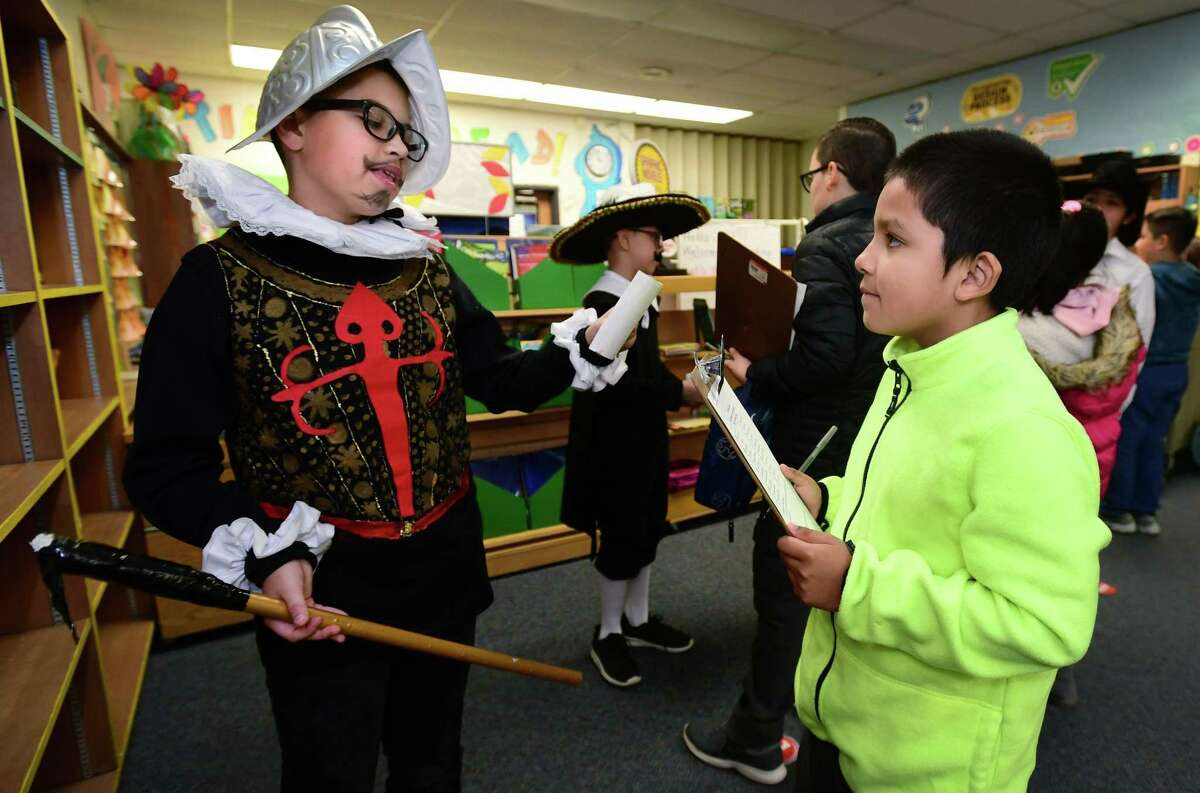 4th grader Yadiel Trujillo, right, learns from students in Dr. Jeffrey M. Beckley, Jr. 5th Grade class including Bryan Venegas who dressed up as explorers like Pedro Del Alvarado in a living museum biography exercise in conjuction with Jefferson Elementary School's Age of Exploration curriculum Friday, November 15, 2019, at the school in Norwalk, Conn. All grades at Jefferson had an opportunity to visit with the students and learn about the explorers the 5th graders portrayed.
