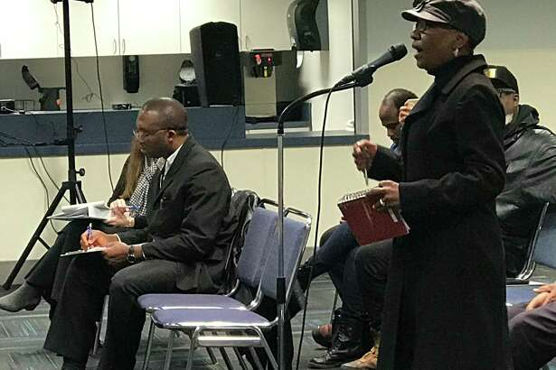 Several Port Arthur residents on Thursday gathered to give the Texas Commission on Environmental Quality comments against renewing a permit held by Oxbow Calcining.