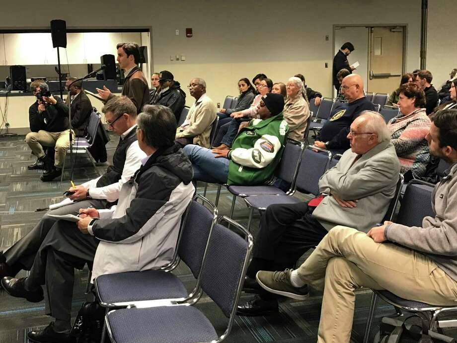 Several Port Arthur residents on Thursday gathered to give the Texas Commission on Environmental Quality comments against renewing a permit held by Oxbow Calcining. Photo: Kaitlin Bain