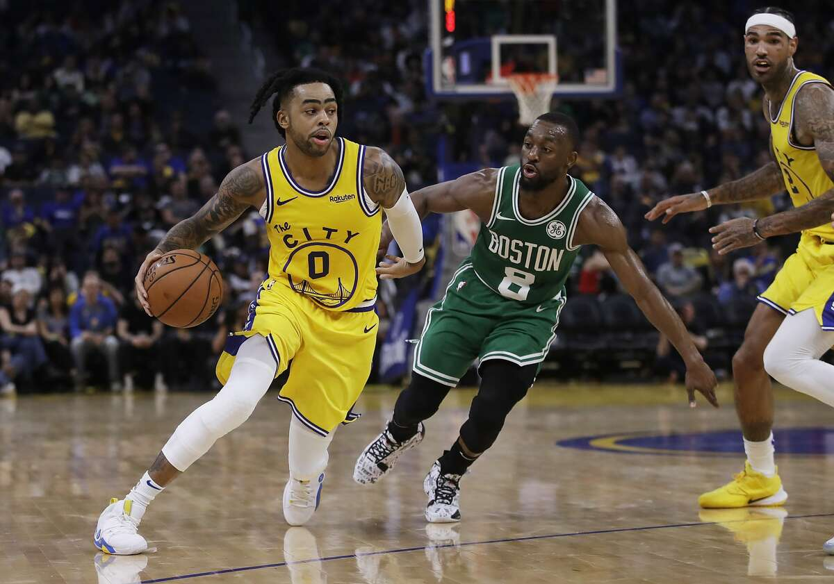 Golden State Warriors' D'Angelo Russell, left, drives the ball past Boston Celtics' Kemba Walker (8) during the second half of an NBA basketball game Friday, Nov. 15, 2019, in San Francisco.