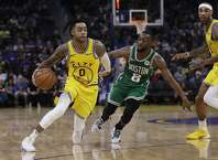 Golden State Warriors' D'Angelo Russell, left, drives the ball past Boston Celtics' Kemba Walker (8) during the second half of an NBA basketball game Friday, Nov. 15, 2019, in San Francisco. (AP Photo/Ben Margot)