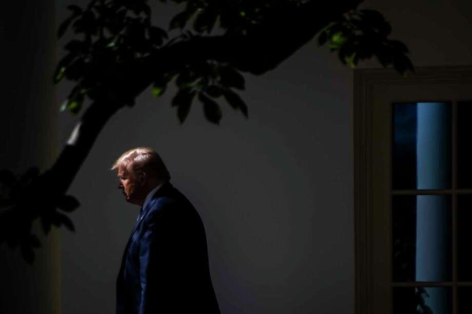 President Donald Trump walks toward Marine One on the South Lawn of the White House on Oct. 23. Photo: Washington Post Photo By Jabin Botsford / The Washington Post