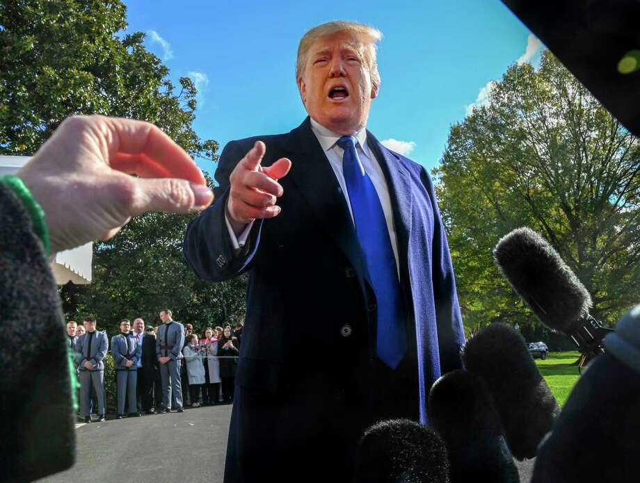 Trump talks to reporters this month before leaving the White House for a campaign event in Georgia. Photo: Washington Post Photo By Bill O'Leary / The Washington Post