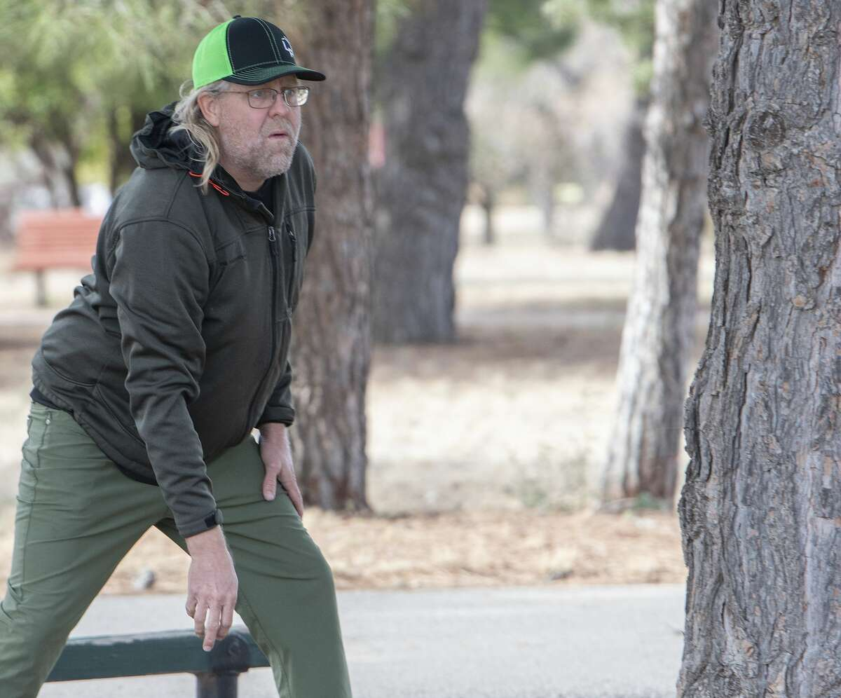 Jay Midkiff watches his throw toward the hole 11/16/19 at the 8th annual Oilfield Blowout Low Putt Disc Golf Tournament at Windlands Park. Tim Fischer/Reporter-Telegram