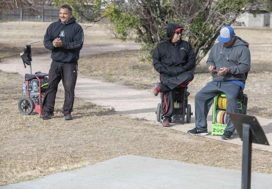 Jubel Scarborough, Jr. Esparza and Angel Acosta wait to tee off 11/16/19 at the 8th annual Oilfield Blowout Low Putt Disc Golf Tournament at Windlands Park. Tim Fischer/Reporter-Telegram Photo: Tim Fischer/Midland Reporter-Telegram