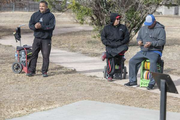 Jubel Scarborough, Jr. Esparza and Angel Acosta wait to tee off 11/16/19 at the 8th annual Oilfield Blowout Low Putt Disc Golf Tournament at Windlands Park. Tim Fischer/Reporter-Telegram