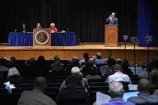 Moderator Thomas Byrne, right, speaks during the Representative Town Meeting at Central Middle School in 2015. The RTM has long fashioned itself as a non-partisan board but that perception may well no longer meet reality.
