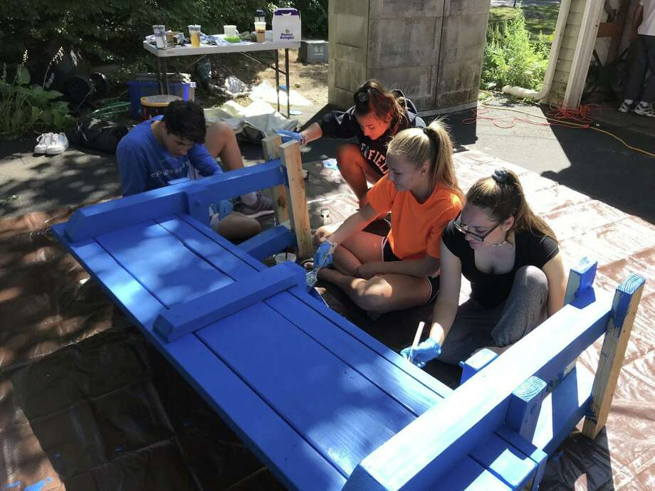 Volunteers and Round Table staff members Sophia Unmpierrez, Anistyn Boshka, Sophia Negyesi and Brayden Davis assist with the Buddy Benches. Photo: Contributed / Contributed Photo / Westport News contributed
