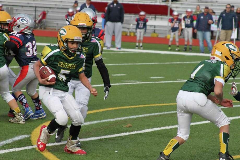 Bantam Crusher Matisse Sostre scores a touchdown. Photo: Contributed Photo